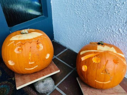 2 Puca Pumkins. Faces cut into pumpkins. Ben and Holly. Eoin O'Keeffe Architects